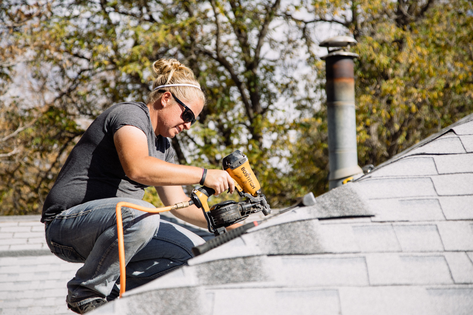 Housing Specialist Steph Crabtree roofing as a part of a Fix It First repair