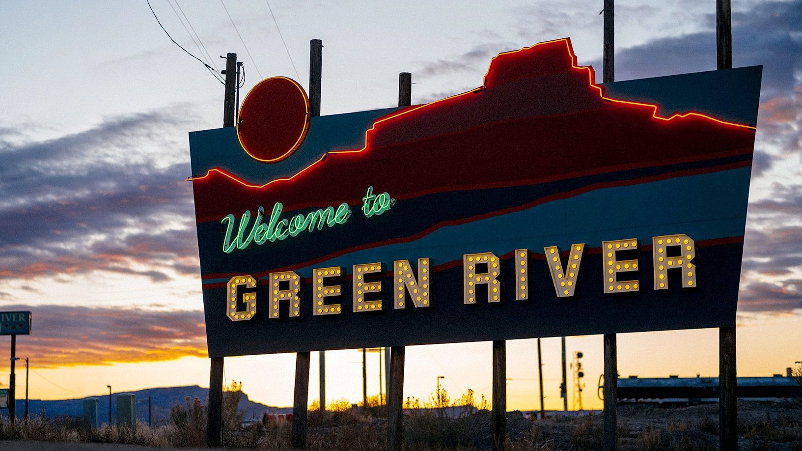The Green River Welcome Sign at sunrise. Photo by John Watson