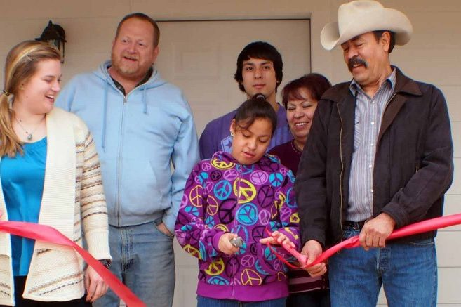 The Mendozas cut the ribbon on their new home, built by Epicenter and Habitat for Humanity
