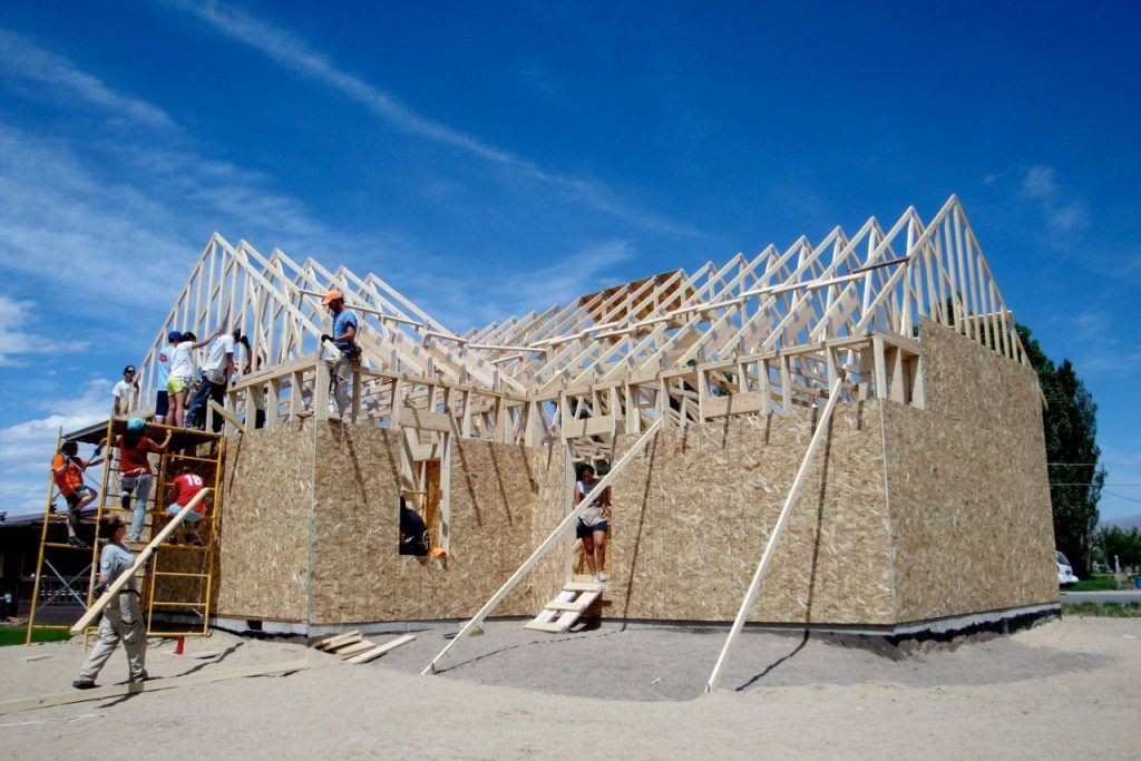 Trusses going up on the first Habitat for Humanity house in Green River