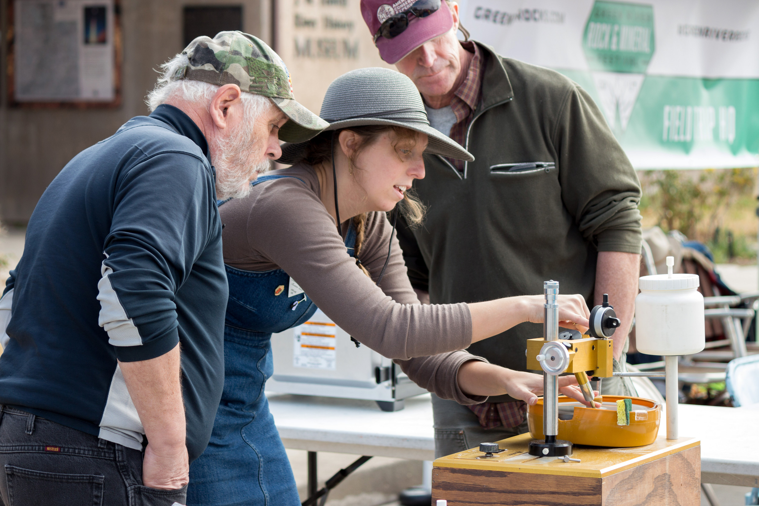 Frontier Fellow Kirsten Southwell demonstrates gem faceting at Festival HQ